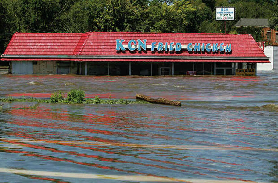 A restaurant is seen in floodwaters from the Passaic River, which overflowed its banks following Hurricane Irene, Tuesday, Aug. 30, 2011 in Paterson, N.J. Many questions faced New Jerseyans as most rivers began to recede and expose a path of destruction that seemed to touch all corners of the state. (AP Photo/Julio Cortez) / AP