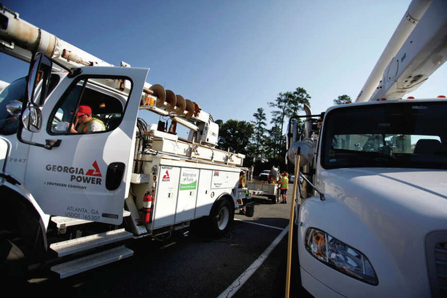 Mike Brock of Gainesville, Ga,, with a Georgia Power , arrives in Richmond, Va. to help with power restoration on Tuesday, Aug. 30, 2011. (AP Photo/ Richmond Times-Dispatch, Dean Hoffmeyer) / RICHMOND TIMES-DISPATCH