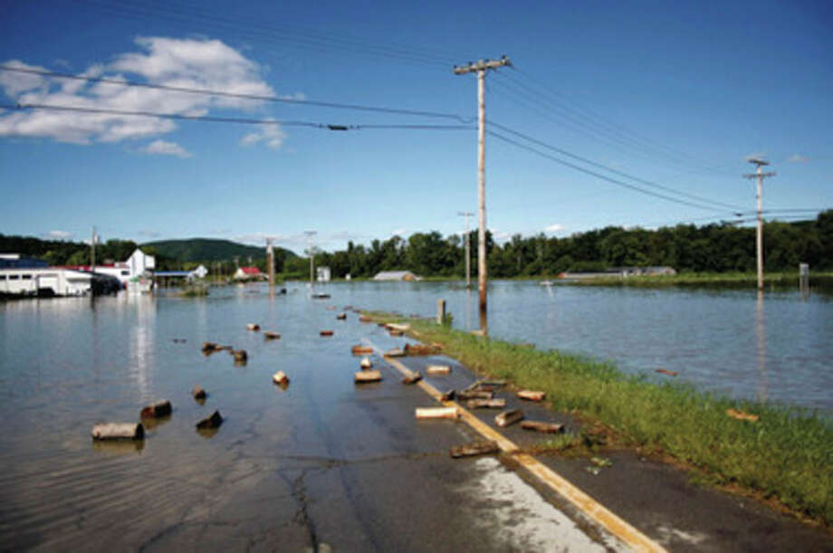 Water from the Connecticut River floods Route 5 in Westminster, Vt. Tuesday, Aug. 30, 2011, after Tropical Storm Irene moved through the area over the weekend. (AP Photo/The Brattleboro Reformer, Zachary P. Stephens) / Brattleboro Reformer