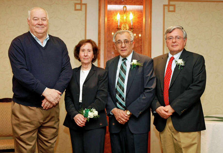 Hour photos / Danielle RobinsonLee Johnson, Nancy Surace, Edward Farris (on behalf of late wife Louise Farris) and Howard Stolzenberg smile after being inducted to the NHSAA Teacher Honor Roll Sunday afternoon at the Norwalk Inn.
