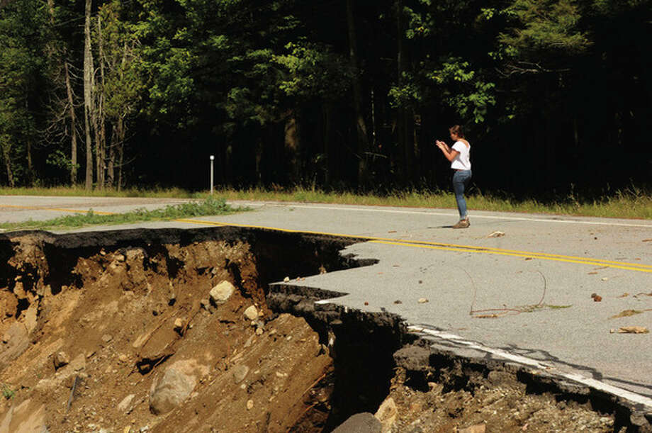 Road damage caused by Tropical Storm Irene on Rt.73in St.Huberts, N.Y., Monday, Aug. 29, 2011. (AP Photo/Hans Pennink) / Hans Pennink