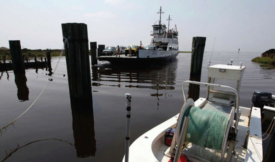 The second emergency ferry of the day pulls into the ferry landing in Rodanthe, N.C., carrying emergency aid workers on Monday, Aug. 29, 2011. Rodanthe is one of the communities on Hatteras Island on the N.C. Outer Banks that was cut off from the mainland by several breaches in N.C. Highway 12 during Hurricane Irene. The emergency ferry is currently the only link to the mainland, and is carrying emergency workers and supplies. (AP Photo/The News & Observer, Chuck Liddy) / 2011 The News & Observer