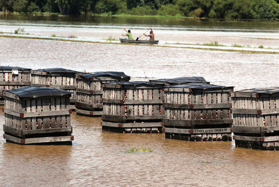 Crates of onions sit in the flooded Black Dirt fields along Pulaski Highway outside Pine Island, N.Y. on Tuesday afternoon, Aug. 30, 2011. While all eyes were on the coast as Irene swirled northward, some of the worst destruction took place well inland, away from the storm's most punishing winds. (AP Photo/Times Herald-Record, Dominick Fiorille) / Times Herald-Record