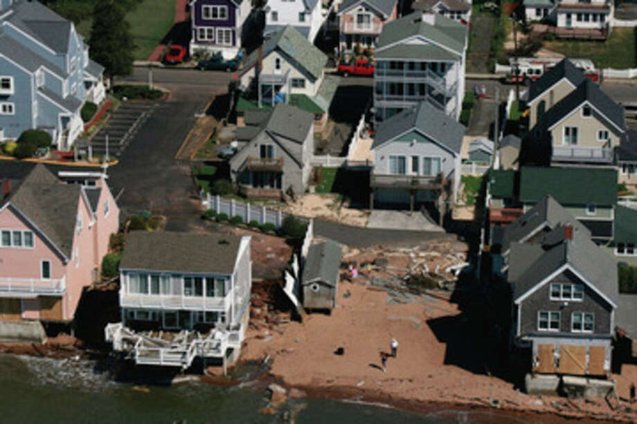This Monday Aug. 29, 2011 aerial photo released by the Connecticut Governor's Office shows homes along the shore of Long Island Sound in East Haven, Conn., damaged Sunday by Tropical Storm Irene. (AP Photo/Connecticut National Guard, John Whitford) / Connecticut National Guard