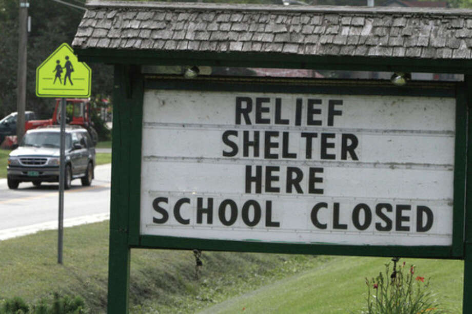 A sign shows the location of a shelter and advises a school closing on Wednesday, Aug. 31, 2011 in Bethel, Vt. Officials say at least five Vermont schools are closed until further notice and about 120 have delayed opening for the school year because of roads or schools ravaged by flooding from Tropical Storm Irene. (AP Photo/Toby Talbot) / AP