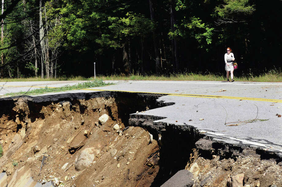 Road damage caused by Tropical Storm Irene on Rt.73 in St.Huberts, N.Y., Monday, Aug. 29, 2011. (AP Photo/Hans Pennink) / Hans Pennink