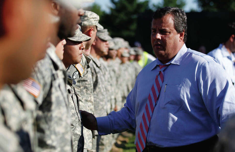 New Jersey Gov. Chris Christie talks to New Jersey National Guardsmen at a command center for Hurricane Irene near the Essex County Airport, Tuesday, Aug. 30, 2011, in Fairfield, N.J. Many questions faced New Jerseyans as most rivers began to recede and expose a path of destruction that seemed to touch all corners of the state. (AP Photo/Julio Cortez) / AP