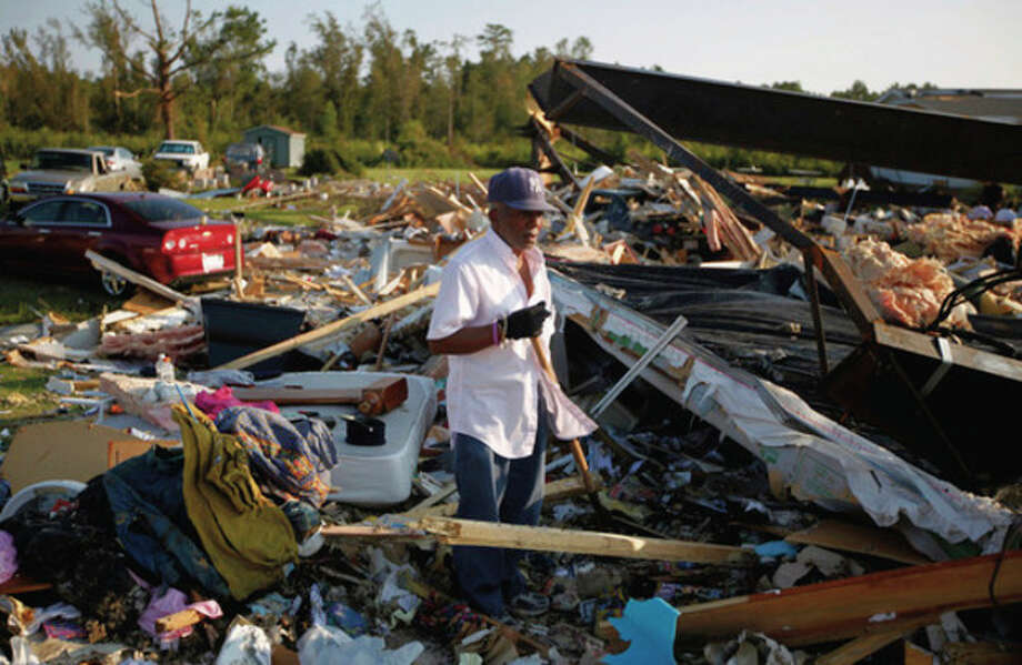 """Henry Rhines tries to salvage anything he can from the debris field that was once his home in Columbia, N.C. on Tuesday, Aug. 30, 2011. A number of houses along U.S. 64 south of Columbia were destroyed when a tornado touched down on Friday night before Hurricane Irene's wind and rain. Rhines wasn't home at the time, evacuating to Rocky Mount earlier in the day. """"That tornado put a hurting on us right on down the line. (AP Photo/The News & Observer, Shawn Rocco) / Copyright 2011, The News & Observer"""