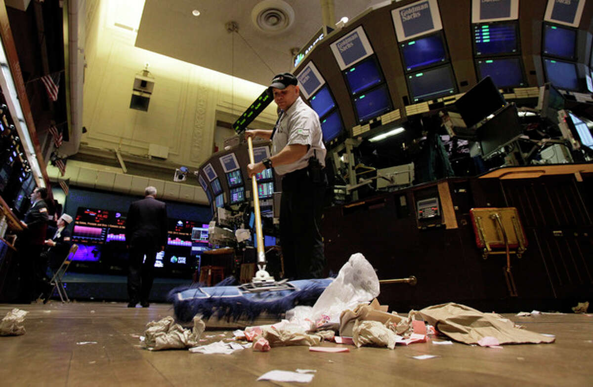 In this Friday, June 1, 2012, file photo, Raul Rodriguez sweeps the trading floor of the New York Stock Exchange. Faced with a fizzling job market, many economists have turned more pessimistic and no longer think U.S. economic growth will accelerate later this year. (AP Photo/Richard Drew, File)