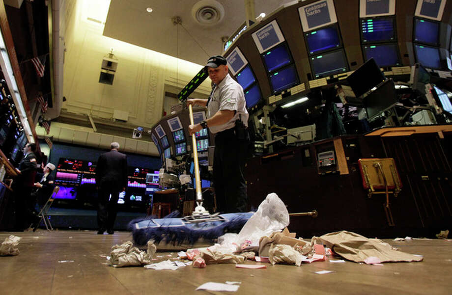 In this Friday, June 1, 2012, file photo, Raul Rodriguez sweeps the trading floor of the New York Stock Exchange. Faced with a fizzling job market, many economists have turned more pessimistic and no longer think U.S. economic growth will accelerate later this year. (AP Photo/Richard Drew, File) / Copyright 2012 The Associated Press. All rights reserved. This material may not be published, broadcast, rewritten or redistributed.