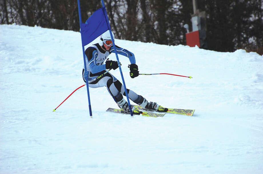 Photo by Colette PoirierWilton senior John Williams races down the mountain during Monday's Connecticut Interscholastic Ski League championship meet at the Mount Southington ski area.