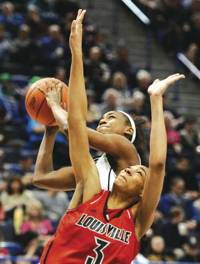 AP photoNotre Dame's Jewell Loyd top, shoot over Louisville's Sheronne Vails in the second half of Tuesday's Big East Conference tournament game in Hartford. Notre Dame won, 83-59.