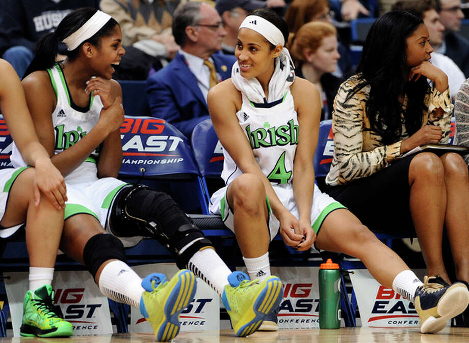 Notre Dame's Ariel Braker, left, and Skylar Diggins talk in the final minutes of an NCAA college basketball game against Louisville in the semifinals of the Big East Conference tournament in Hartford, Conn., Monday, March 11, 2013. Notre Dame won 83-59. (AP Photo/Jessica Hill) / FR125654 AP