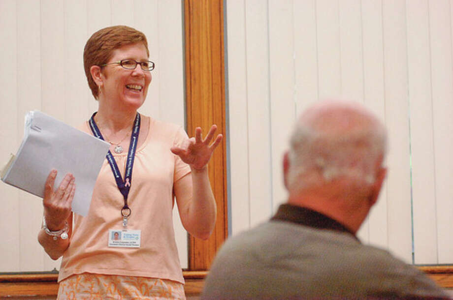 Kristin Carpenter from Visiting Nurse and Hospice gives a talk on the science of happiness at the Norwalk Senior Center Wednesday.Hour photo / Erik Trautmann / (C)2012, The Hour Newspapers, all rights reserved