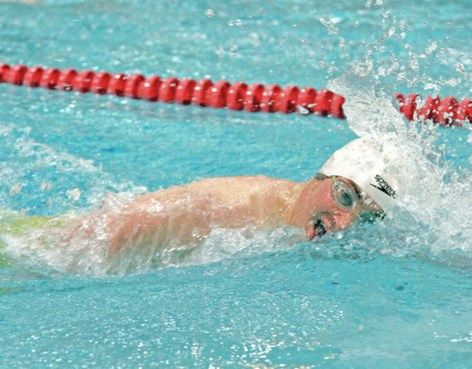 Hour photo/Danielle RobinsonWeston's Gabriel Imbercompetes in the 500-yard freestyle during Wednesday's CIAC Class S boys swim championships at Wesleyan University. Im ler finished third in the event. Weston easily outdistanced Sacred Heart of Waterbury to claim the team championship.
