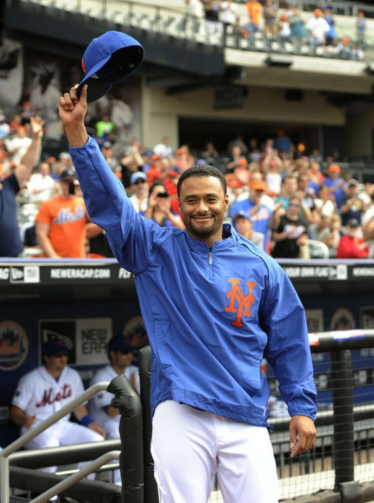 New York Mets' Johan Santana waves his cap to the cheers of the fans after a video was shown before the baseball game against the St. Louis Cardinals, on Saturday, June 2, 2012, at Citi Field in New York, in tribute to his no-hitter the night before. (AP Photo/Kathy Kmonicek)