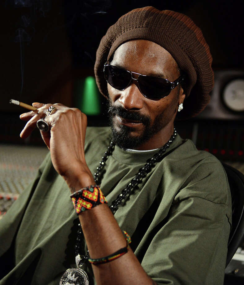 In this Tuesday, March 5, 2013 photo, Snoop Lion poses for a portrait at the Westlake Recording Studios in Los Angeles. How committed is Snoop Dogg to his new moniker Snoop Lion? While promoting an accompanying documentary that tracks his trip to Jamaica and exploration of the Rastafarian culture and religion, Snoop says Lion is less a lifestyle transformation than a personal evolution. (Photo by Jordan Strauss/Invision/AP) / Invision