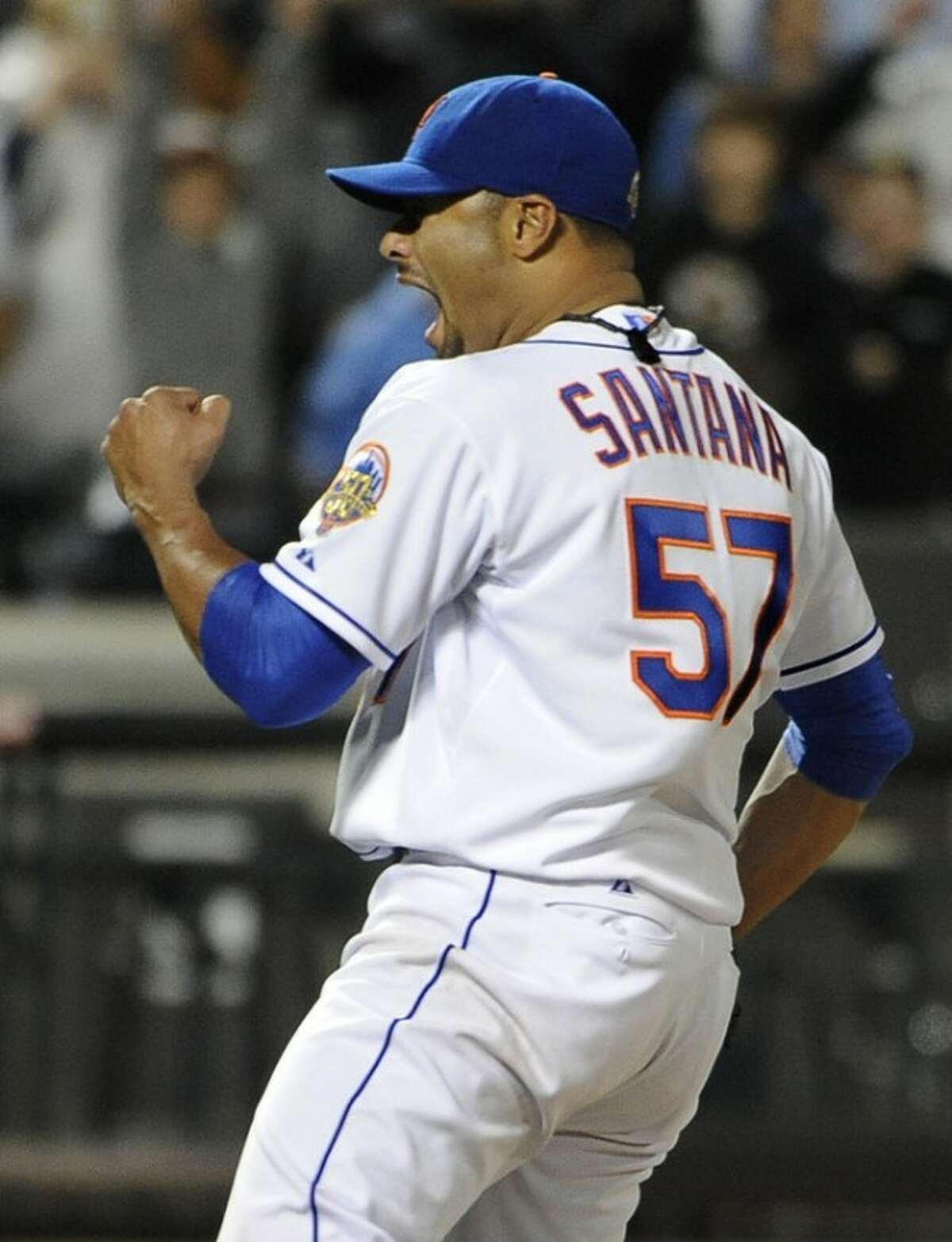 New York Mets starting pitcher Johan Santana (57) celebrates his no-hitter against the St. Louis Cardinals at the end of a baseball game on Friday, June 1, 2012, at Citi Field in New York. The Mets won 8-0. (AP Photo/Kathy Kmonicek)