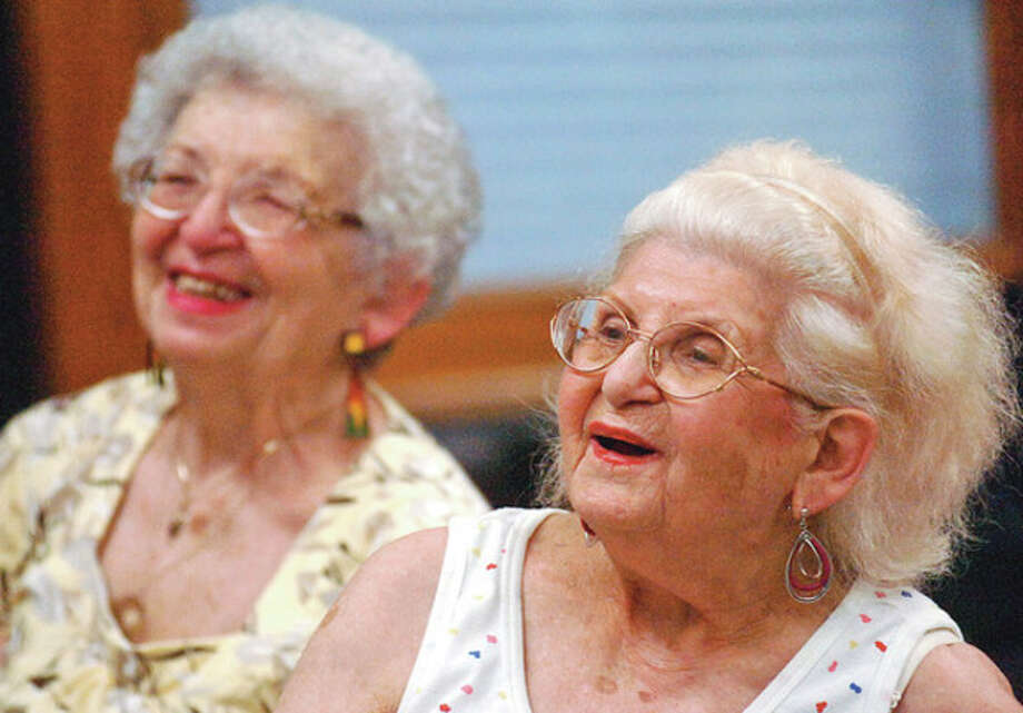 Myra Dashesky and Sandra Ruttenberg listen to Kristin Carpenter from Visiting Nurse and Hospice give a talk on the science of happiness at the Norwalk Senior Center Wednesday.Hour photo / Erik Trautmann / (C)2012, The Hour Newspapers, all rights reserved