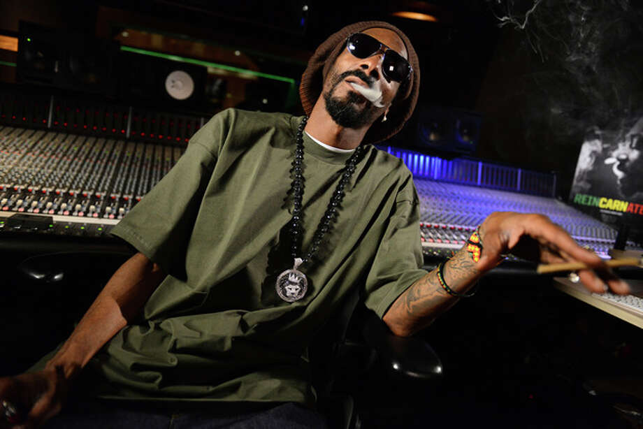 In this Tuesday, March 5, 2013 photo, Snoop Lion poses for a portrait at the Westlake Recording Studios in Los Angeles. How committed is Snoop Dogg to his new moniker Snoop Lion? He is using the name to release a reggae- and dancehall-focused album releasing on April 23, 2013. (Photo by Jordan Strauss/Invision/AP) / Invision