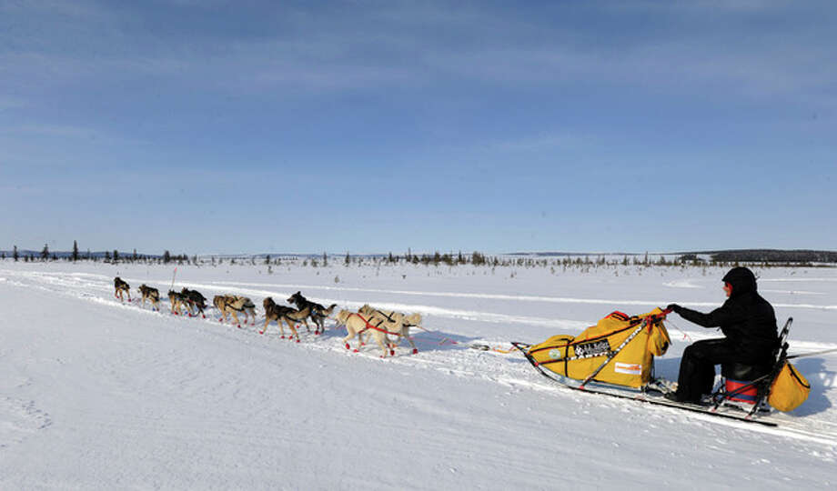 Mitch Seavey drives his dog team towards Nome, Alaska, after leaving the White Mountain checkpoint, Tuesday, March 12, 2013, during the Iditarod Trail Sled Dog Race. (AP Photo/The Anchorage Daily News, Bill Roth) LOCAL TV OUT (KTUU-TV, KTVA-TV) LOCAL PRINT OUT (THE ANCHORAGE PRESS, THE ALASKA DISPATCH) / The Anchorage Daily News