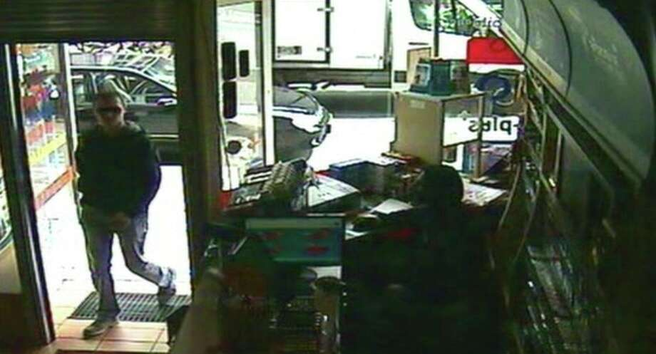 "This image taken from CCTV obtained by Associated Press video shows Luka Rocco Magnotta entering the Internet cafe in the district of Neukoelln in Berlin, Germany, Monday, June 4, 2012, where Kadir Anlayisli, who works in the cafe recognized him. ""I looked at him and thought I knew him from somewhere, because I read newspapers every day,"" Anlayisli said. Luka Rocco Magnotta was apprehended on Monday in an Internet cafe in Berlin after an employee there recognized him and alerted police, Berlin police spokeswoman Kerstin Ziesmer said. The 29-year-old Canadian porn actor is accused of videotaping a killing and mailing the victim's body parts to the country's top political parties. (AP Photo/AP Video) / AP Video"