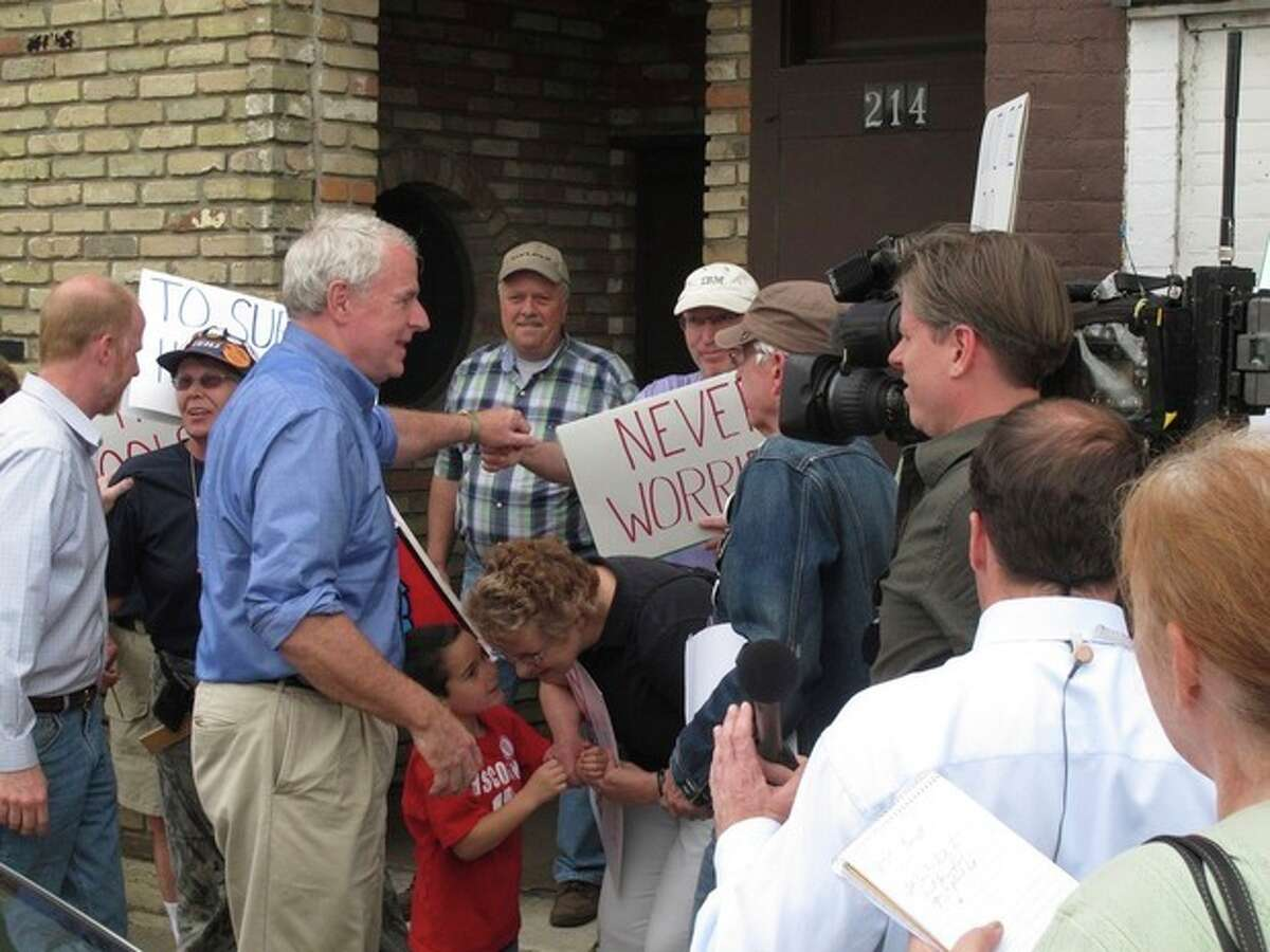 Democratic Milwaukee Mayor Tom Barrett greets supporters outside his campaign office on Monday, June 4, 2012, in Portage, Wis. Barrett faces Republican Gov. Scott Walker in Tuesday's recall election. (AP Photo/Scott Bauer)