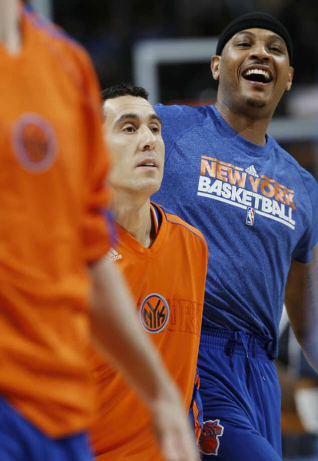 New York Knicks forward Carmelo Anthony, rear, jokes with teammates as they warm up before facing the Denver Nuggets in an NBA basketball game in Denver, Wednesday, March 13, 2013. The game marked Anthony's first at the Pepsi Center after his trade from Denver to New York two years ago. (AP Photo/David Zalubowski)