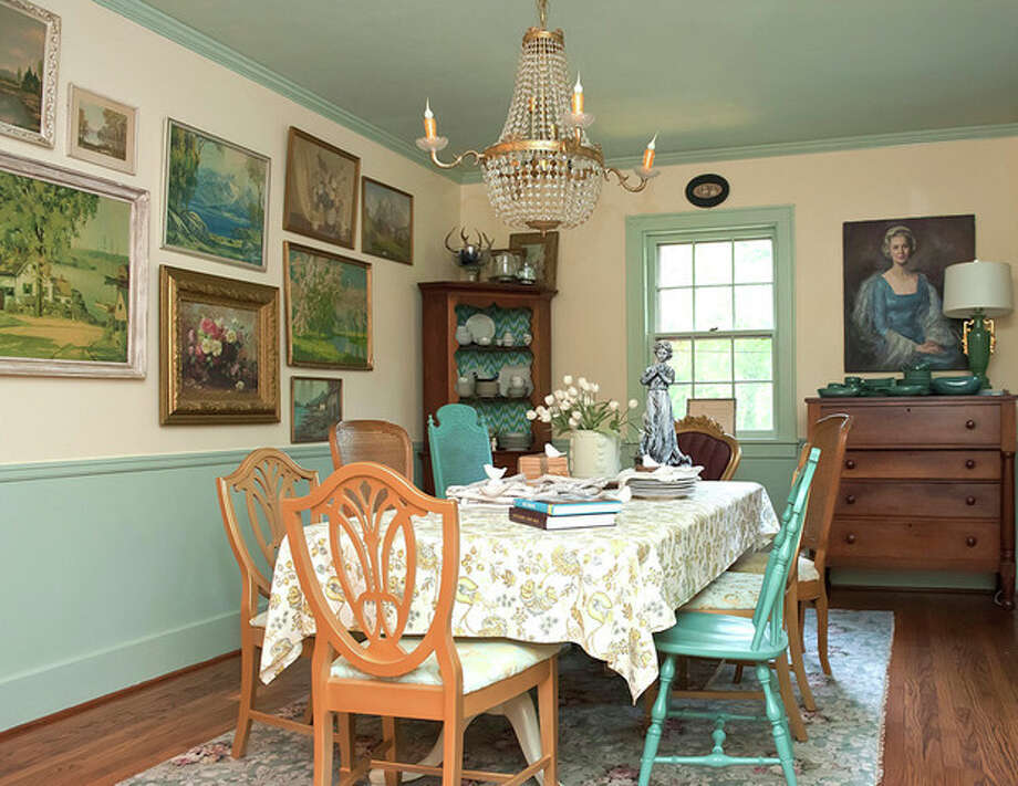 "CAPTION CORRECTION - This August 29, 2012 publicity photo provided by The Decorologist shows Downton Abbey-inspired decor (salon-style art grouping in dining room) in home of Kristie Barnett. Intrigued by the drama and inspired by the sophisticated lifestyle of British aristocracy, many ""Downton Abbey'' fans are plotting to bring the PBS series' style into their homes. From gilded finishes to opulent upholstery to portrait paintings, the style holds appeal to those trying to inject a little more formality and glamour into today's casual home decor. (AP Photo/The Decorologist, Melanie G Photography) / The Decorologist"