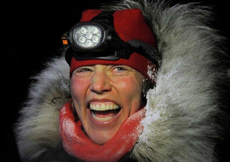 Aliy Zirkle finished second in the Iditarod for the second consecutive year when her dog team crossed under the burled arch in Nome on Tuesday evening, March 12, 2013. (AP Photo/The Anchorage Daily News, Bill Roth) LOCAL TV OUT (KTUU-TV, KTVA-TV) LOCAL PRINT OUT (THE ANCHORAGE PRESS, THE ALASKA DISPATCH) / The Anchorage Daily News