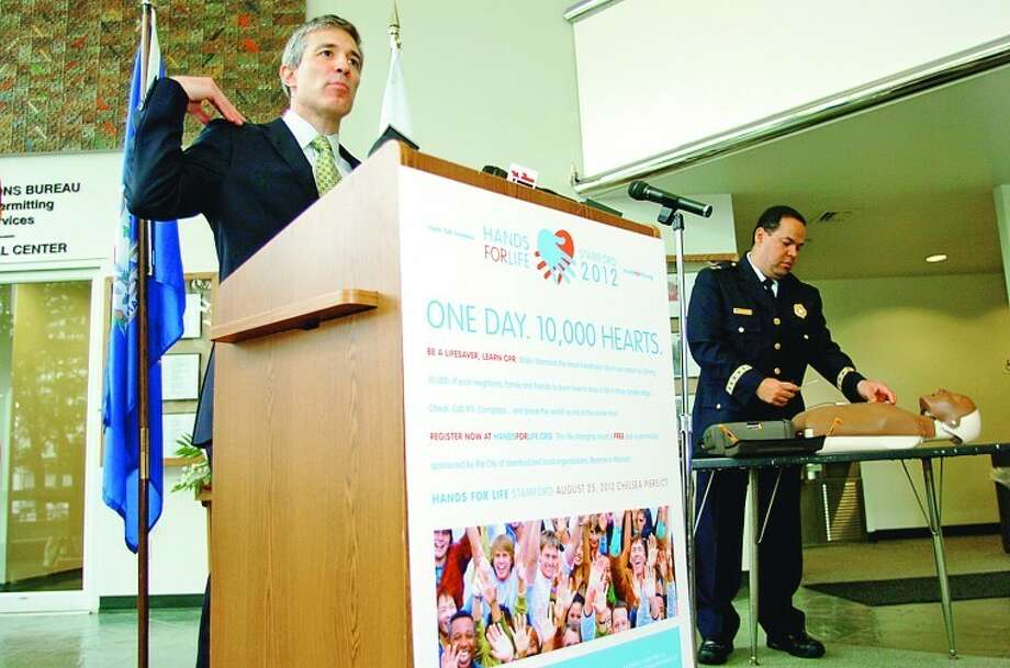 Dr. Thomas Nero, Interventional Cardiologist, speaks about Hands For Life Stamford 2012, the mayor's new health initiative for the city, during a press conference announcing the Aug. 25 event. Hour photo / Erik Trautmann