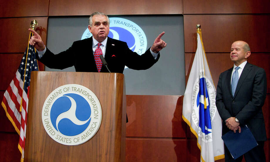 Transportation Secretary Ray LaHood, left, with Federal Aviation Administration Acting Administrator Michael Huerta, speak to reporters during a news conference at the Department of Transportation in Washington, Wednesday, Dec. 21, 2011, announcing a sweeping final rule that overhauls commercial passenger airline pilots scheduling to ensure pilots have a longer opportunity to rest before they enter the cockpit. (AP Photo/Manuel Balce Ceneta) / AP