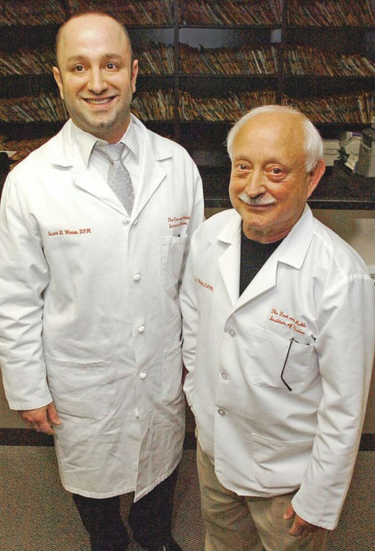 Doctors Scott and Bob Weiss of the Foot & Ankle Institute of Darien, LLC. Hour photo / Erik Trautmann