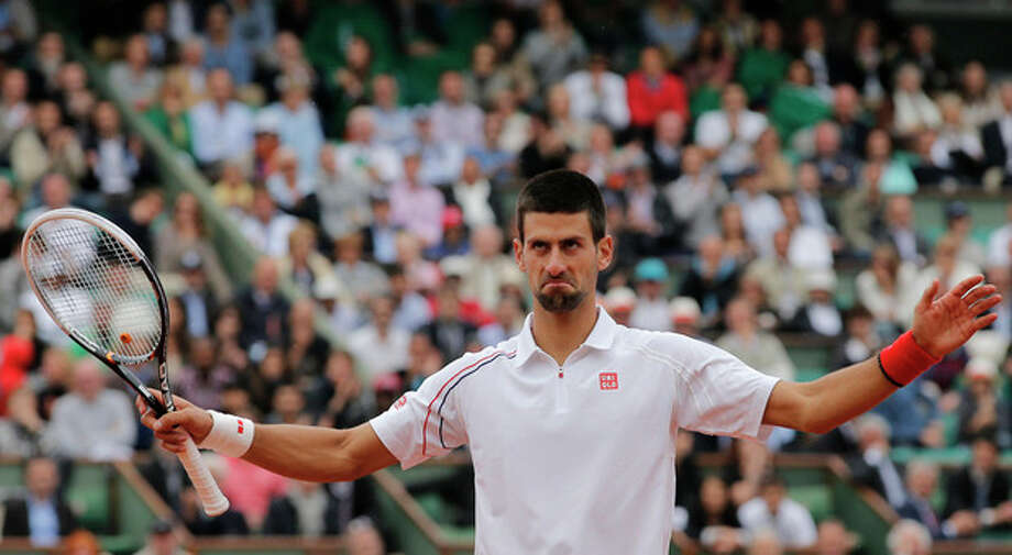 Serbia's Novak Djokovic reacts as he plays France's Jo-Wilfired Tsonga during their quarterfinal match in the French Open tennis tournament at the Roland Garros stadium in Paris, Tuesday, June 5, 2012. (AP Photo/Christophe Ena) / AP