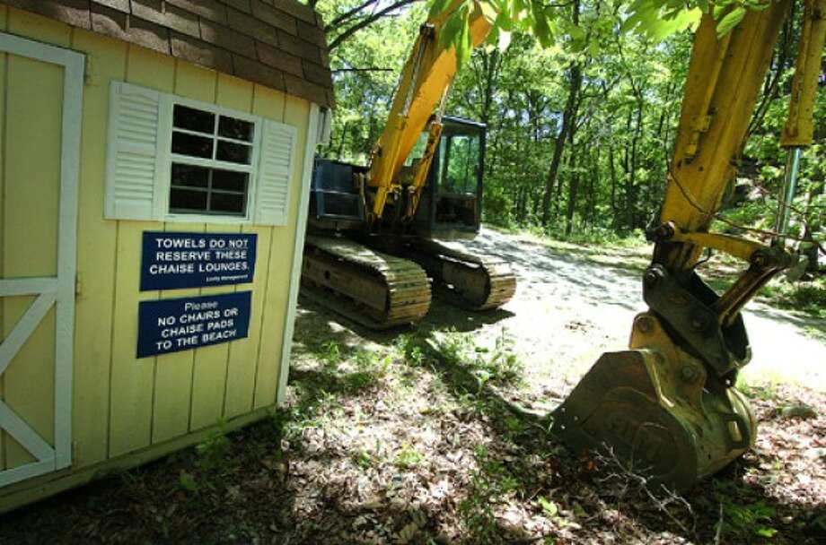 Photo/Alex von Kleydorff. The Pool House sits intact next to an excavator on the side of Old Mill Rd after the pool at the Laskey home was demolished.