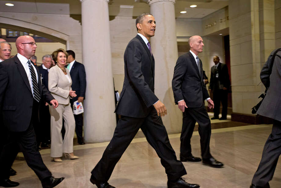 President Barack Obama and House Minority Leader Nancy Pelosi, D-Calif., left, leave a meeting with House Democrats at the Capitol, in Washington, Thursday, March 14, 2013. (AP Photo/J. Scott Applewhite) / AP