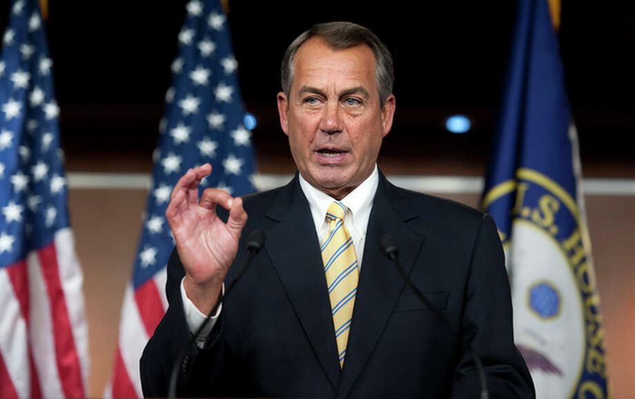 "House Speaker John Boehner of Ohio, makes a ""zero"" gesture as he speaks with reporters about the federal budget on Capitol Hill in Washington, Thursday, March 14, 2013. Boehner was referring to President Barack Obama's federal budget which received zero votes in 2012 when it was rejected 414-0 in the House and 99-0 in the Senate. (AP Photo/Cliff Owen) / FR170079 AP"