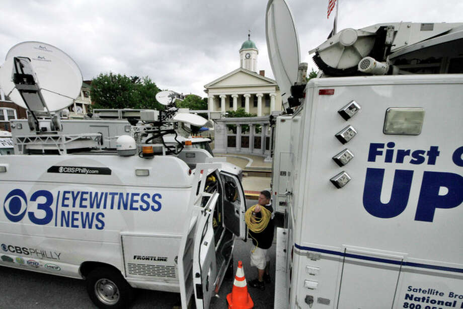 Television satellite trucks set up outside the Centre County Courthouse in Bellefonte, Pa., Monday, June 4, 2012, in preparation for the start of the child sexual abuse trial of former Penn State assistant football coach Jerry Sandusky, on Tuesday. (AP Photo/Gene J. Puskar) / AP