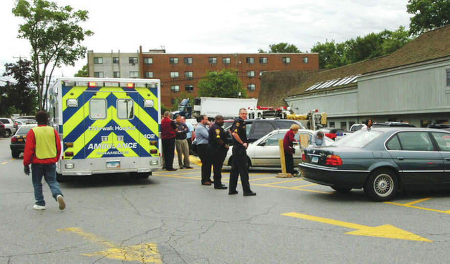 Hour photo / Alex von KleydorffScene of an accident at Stew Leonard's parking lot Tuesday morning / 2012 The Hour Newspapers