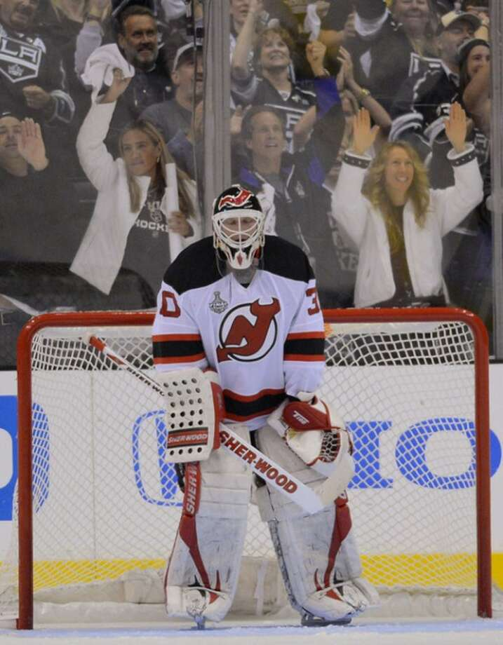 New Jersey Devils goalie Martin Brodeur (30) reacts after a third period goal by the Los Angeles Kings during Game 3 of the NHL Stanley Cup Finals, Monday, June 4, 2012, in Los Angeles. (AP Photo/Mark J. Terrill)