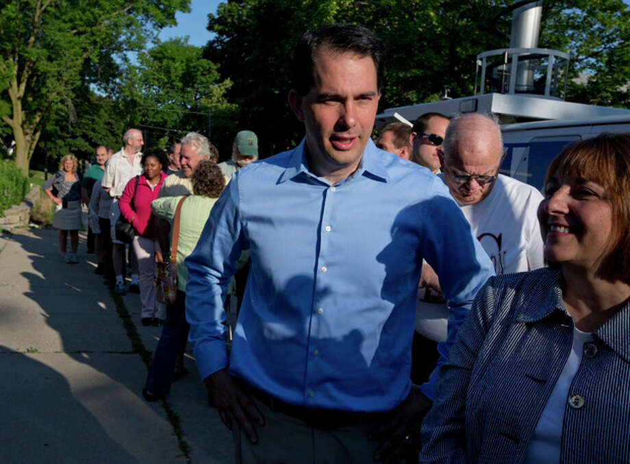 Wisconsin Republican Gov. Scott Walker waits in line to vote Tuesday, June 5, 2012, in Wauwatosa, Wis. Walker faces Democratic challenger Tom Barrett in a special recall election. (AP Photo/Morry Gash) / AP