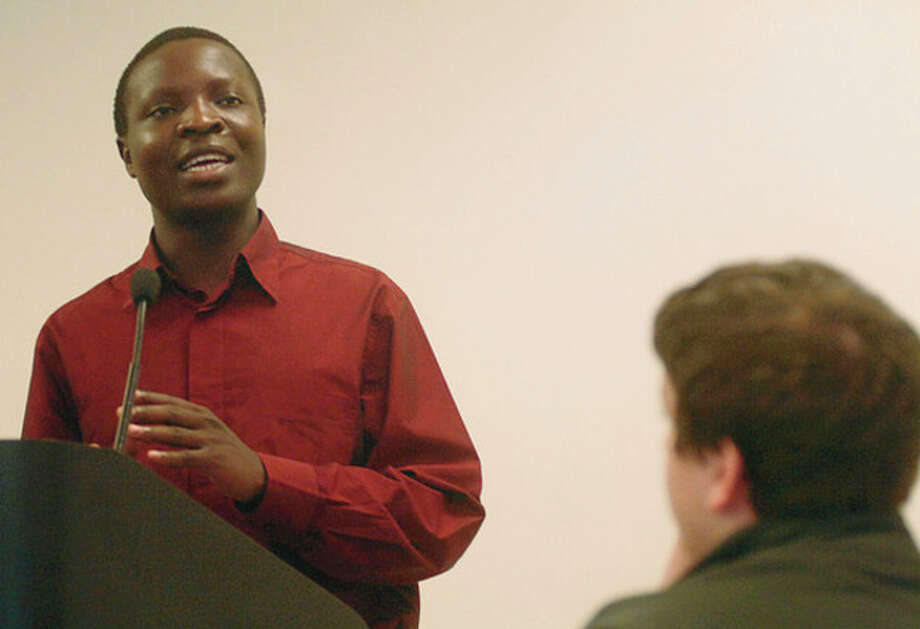"William Kamkwamba, the author and subject of the memoir ""The Boy Who Harnessed the Wind,"" speaks with students and faculty at AITE on Wednesday. Hour photo / Erik Trautmann / (C)2011, The Hour Newspapers, all rights reserved"