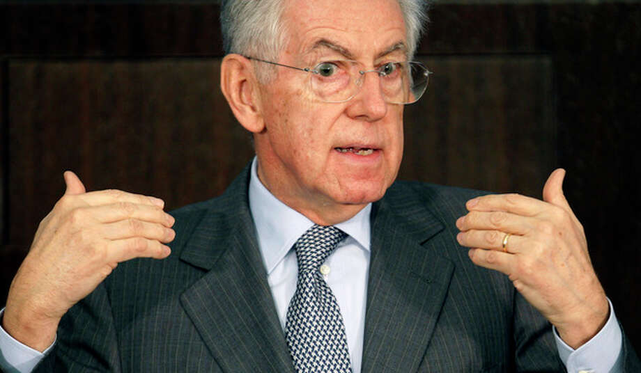 Italian Premier Mario Monti speaks during a news conference in Rome, Thursday, Dec. 29, 2011. Italy saw its borrowing rates fall for the second day running on Thursday but the country's new premier said his government had a lot more to do to convince nervous financial markets that it had a plan to deal with its debt mountain. (AP Photo/Pier Paolo Cito) / AP