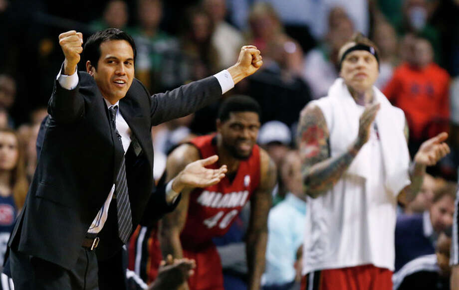 Miami Heat head coach Erik Spoelstra, left, reacts to play in the fourth quarter of an NBA basketball game against the Boston Celtics in Boston, Monday, March 18, 2013. The Heat won 105-103. (AP Photo/Michael Dwyer) / AP