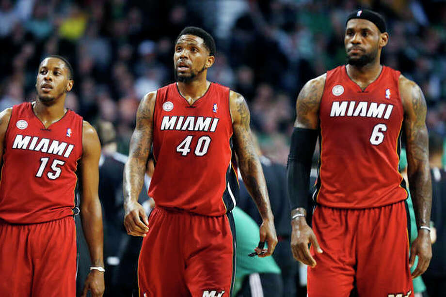 Miami Heat's Mario Chalmers (15), Udonis Haslem (40) and LeBron James (6) walk upcourt after a timeout in the first quarter of an NBA basketball game against the Boston Celtics in Boston, Monday, March 18, 2013. (AP Photo/Michael Dwyer) / AP