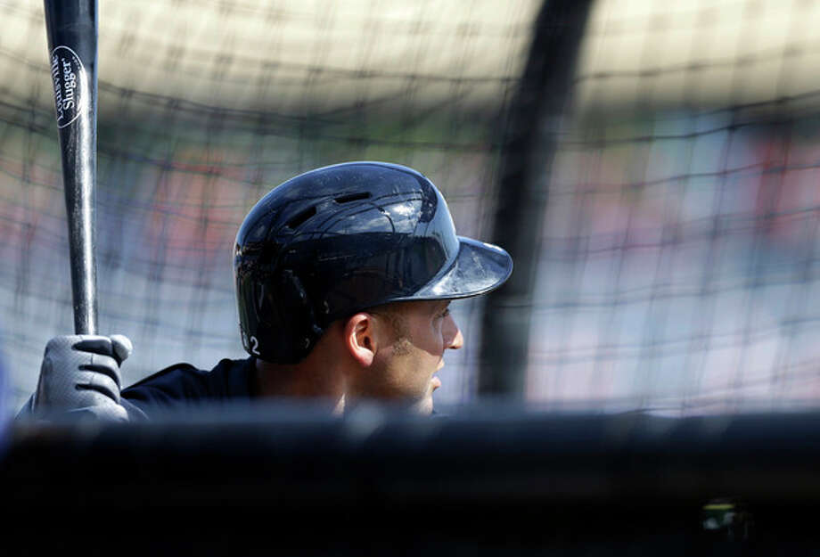 New York Yankees shortstop Derek Jeter takes batting practice before a spring training baseball game in Clearwater, Fla., Tuesday, March 19, 2013. Jeter was pulled from the lineup. (AP Photo/Kathy Willens) / AP