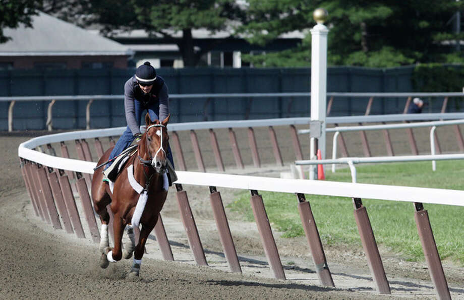 I'll Have Another, with exercise rider Jonny Garcia up, trains at Belmont Park, Wednesday, June 6, 2012, in Elmont, N.Y. The winner of the Kentucky Derby and Preakness will attempt to win the Belmont Stakes and Triple Crown on Saturday. (AP Photo/Mark Lennihan) / AP