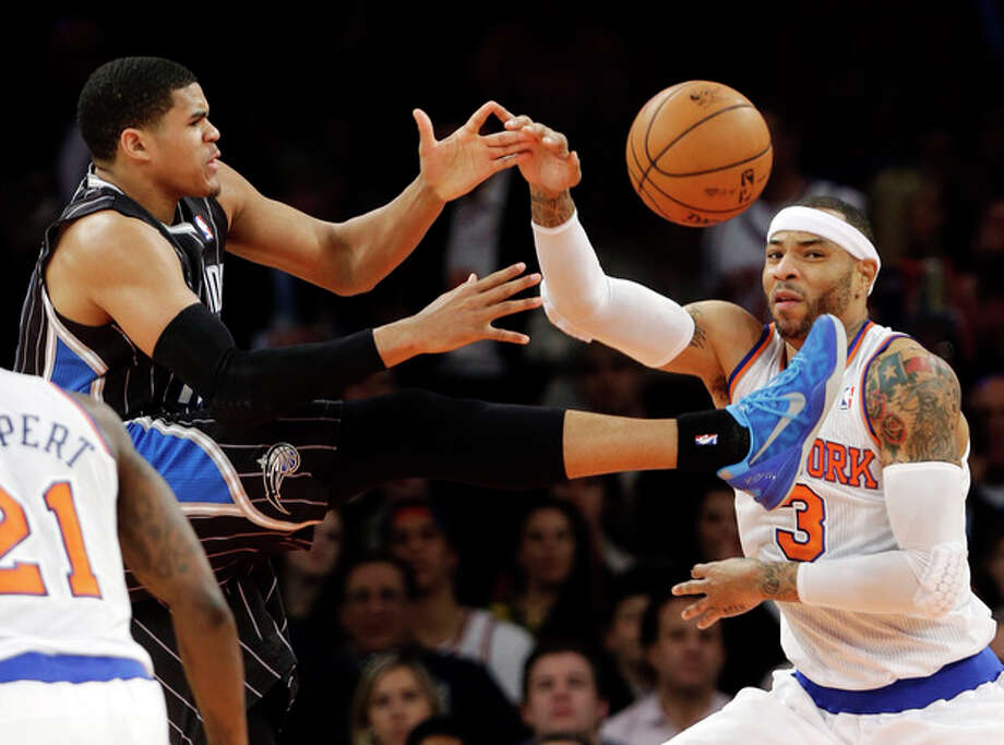 Orlando Magic's Tobias Harris (12) loses control of the ball as New York Knicks' Kenyon Martin (3) defends during the first half of an NBA basketball game, Wednesday, March 20, 2013, in New York. (AP Photo/Frank Franklin II) / AP