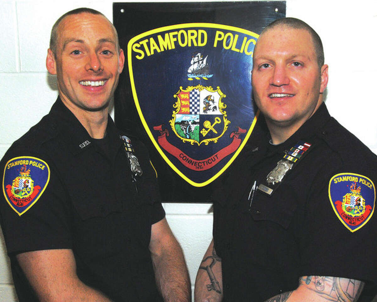 Contributed photo Stamford Police Officers Rhett Connelly, left, and Troy Judge, who were both named the 2011 Officers of the Year by the Stamford Police Association.