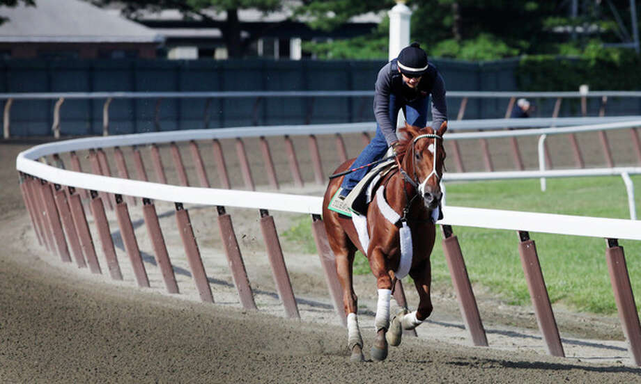 I'll Have Another, with exercise rider Jonny Garcia up, trains at Belmont Park, Wednesday, June 6, 2012, in Elmont, N.Y. The winner of the Kentucky Derby and Preakness will attempt to win the Belmont Stakes and Triple Crown Saturday. (AP Photo/Mark Lennihan) / AP